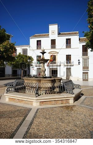 Estepa, Spain - November 13, 2008 - Fountain In The Plaza Del Carmen With The Town Hall (ayuntamient