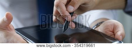 Focus On Male Hands Holding Modern Tablet. Business Partner Showing Something With Stylos. Empty Cop