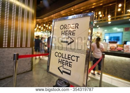SINGAPORE - JANUARY 20, 2020: close up shot of a direction sign seen at a food court in the Shoppes at Marina Bay Sands
