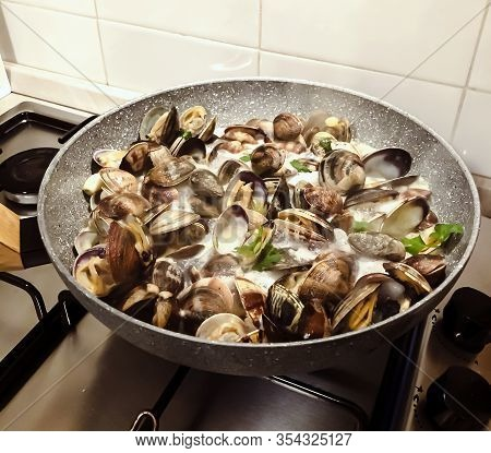 Cooking Clams In A Stone Pan Using Parsley And White Wine. Cuisine And Restaurant Recipes. Shell Sea