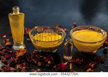 Close Up Shot Of Ghee And Rose Oil Face Mask In A Glass Bowl Along With Some Raw Ghee, Essential Ros