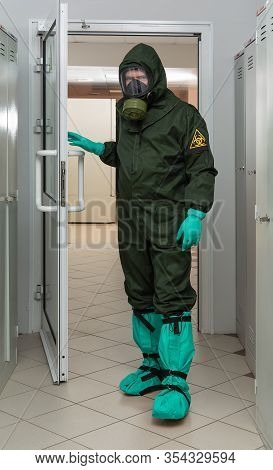 Men In A Biohazard Protective Suit In Laboratory. Protection Against Sars-cov-2, Covid-19, 2019-ncov