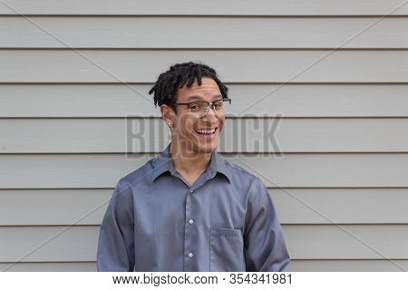 Young Bi-racial Male, Quarter Turn With Open Smile, Happy Man With Natural Hairstyle Dreadlocks, Hor