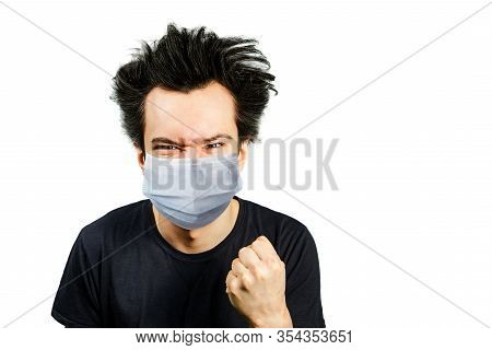 Mad Young Man Wearing A Protective Face Mask Prevent Virus Infection Or Pollution With Fist On White