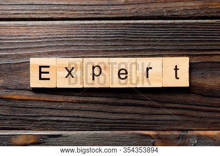 Expert Word Written On Wood Block. Expert Text On Table, Concept