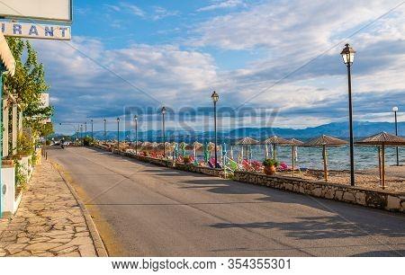 Amazing Road Near Bay With Clear Water On Corfu Island, Greece. Beautiful Landscape Of Ionian Sea Be