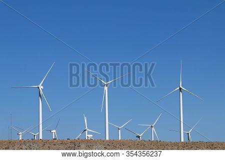 Hillside View Wind Farm Bright White Turbines Blue Sky