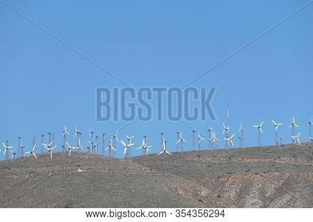 Large Row Of Vintage Wind Turbines Mountain View