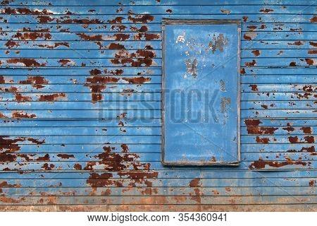 A Blue Rusty Barn Farm Building Wall With Boarded Up Window
