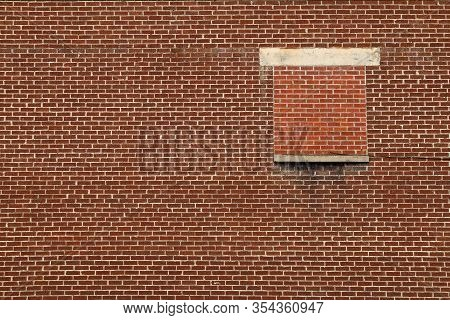 A Single Bricked Up Window On A Red Brick Factory Wall At A Distance View