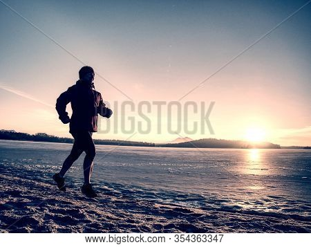 Fitness People, Sport And Healthy Lifestyle Concept - Young Woman In Sport Suit Running Along Ice Co