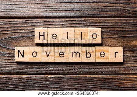 Hello November Word Written On Wood Block. Hello November Text On Table, Concept