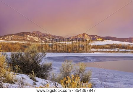 Frozen Colorado Lake At Sunrise