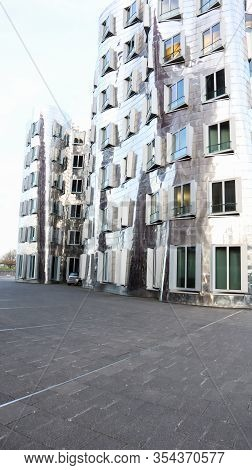 Dusseldorf, Germany - February 20, 2020. Modern Architecture With A Stainless Steel Facade By Canadi