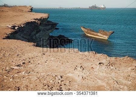 Nouadhibou, Mauritania, January 18, 2020: Abandoned And Derelict Old Shipwreck At The Atlantic Coast