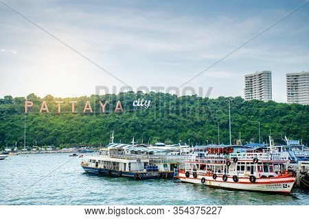 Pattaya, Thailand - Oct 20 ,2019 : The Famous Pattaya City Sign On The Hill At Pattaya Bay With Comm
