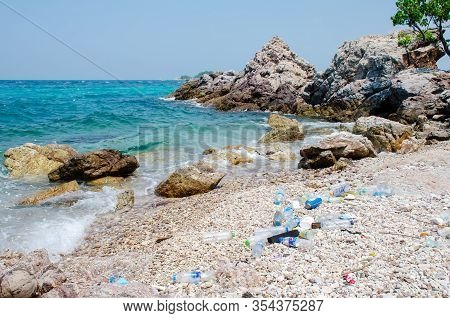 Koh Larn,thailand - Oct 22, 2019: Garbage And Plastic Bottles On A Beach. Empty Used Dirty Plastic B