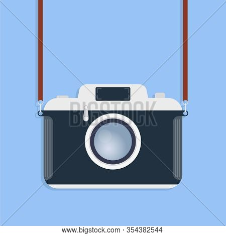 Retro Camera. Old Camera With Strap Isolated On A Blue Background. Vector Illustration Of A Camera.