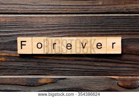 Forever Word Written On Wood Block. Forever Text On Table, Concept
