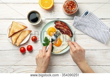 Breakfast Or Lunch With Fried Eggs On Wooden Background, Top View. Woman Eat
