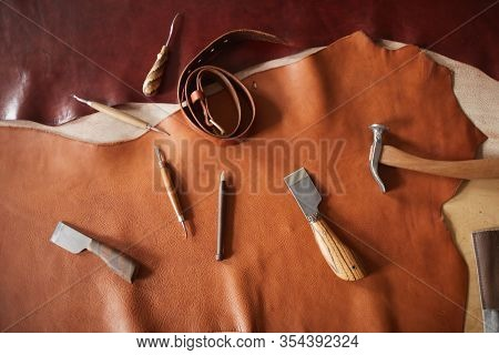 Horizontal From Above Flat Lay Shot Of Various Tools For Craftwork With Leather Materials Lying On T