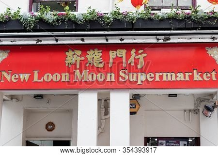 London / Uk - February 22nd 2020  - Signage For New Loon Moon Supermarket Grocery Store In Chinatown