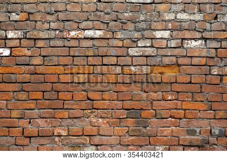 Old Brick Wall. Brickwork From An Old Brick In A Rustic Style. The Structure And Pattern Of The Dest