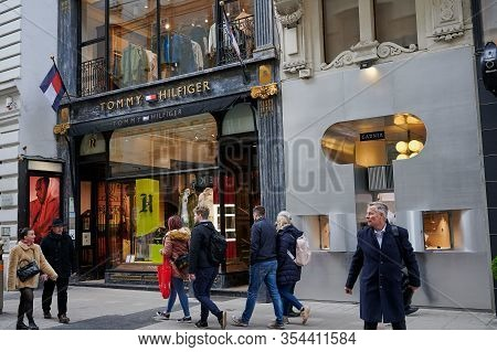 Vienna, Austria - February 19, 2020: People In Front Of A Tommy Hilfiger Store In Vienna. Tommy Hilf
