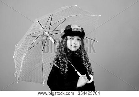 Kid Girl Happy Hold Transparent Umbrella. Enjoy Rainy Weather With Proper Garments. Waterproof Acces