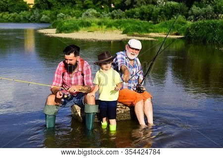 Grandfather And Father With Cute Child Boy Are Fishing. Fishing. Happy Weekend Concept. Outdoors Act