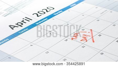 Writing Tax Day Deadline Reminder On April 15 2020 With 1040 Form And Calculator.
