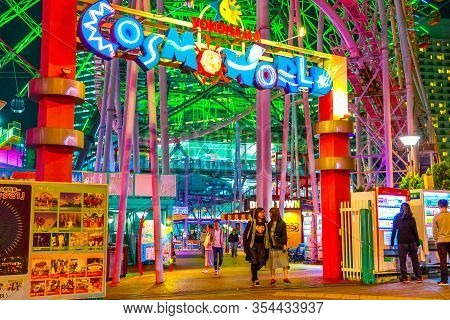 Yokohama, Japan - April 21, 2017: People At Entrance And Signboard Of Cosmo World Amusement Park In