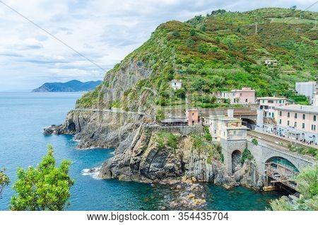 Cinque Terre Train Tracks Underneath Hilly Terrain Of Cinque Terre Village In Italy