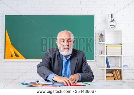 Professor In Classroom At The School. A Teacher Who Works Professionally. A Teacher Who Knows A Lot.