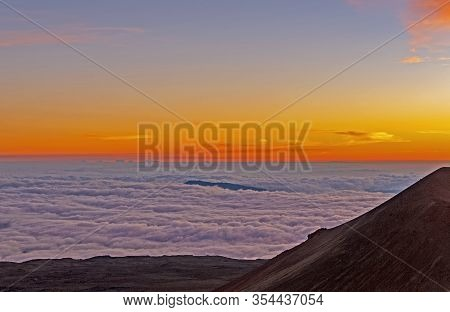 Sunset Above The Clouds In The High Mountains On Mauna Kea In Hawaii