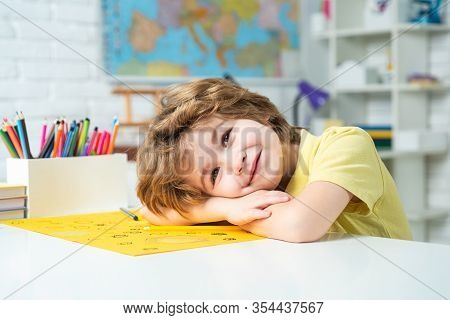 Portrait Of Elementary Pupil Looking At Camera. Schoolkid Or Preschooler Learn. Portrait Of Pupil Of