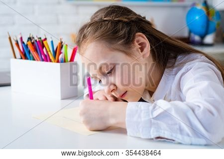 Happy Cheerful Child Girl Drawing. Creativity Concept. Cute Child Drawing Using Felt-tip Pen While S