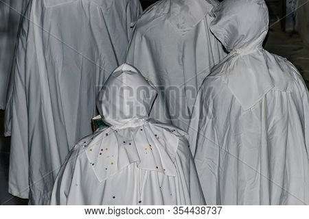 Puget-theniers, France - February 26, 2020: The Traditional Annual Parade Of White Penitents