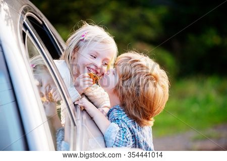 Bye Bye. Little Boy Say Good Bye With Little Girl. Farewell Concept. Gives Warm Kiss. Couple Saying