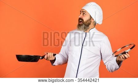 High Quality Frying Pan. Bearded Man Cook White Uniform. Cooking Like Pro. Regular Cooking. Easy Tas
