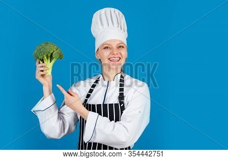 Raw Food. Healthy Green Organic Raw Broccoli. Ready For Cooking. Woman Eating Broccoli. Turn Broccol