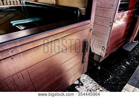 A Vintage Perspective Shot Of Traditional Wooden Steam Train Bogey Inside Melbourne, Australia