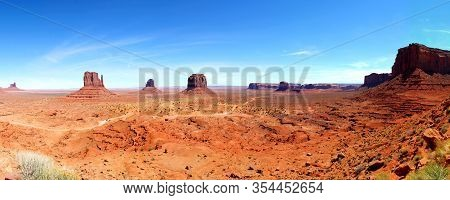 Beautiful Day In The Monument Valley - Panoramic View: The West And East Mitten Buttes With Merrick