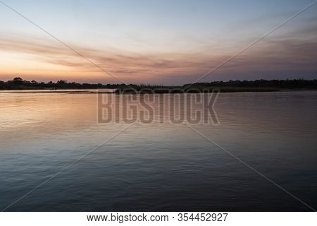 Serene, Tranquil Okavango River Landscape Near Divundu At Dusk In The Evening, Serenity Or Tranquili