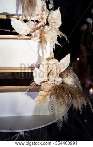 Part Unusual Square White Tiered Wedding Cake With Feathers. A Traditional Treat For The Feast Of Th