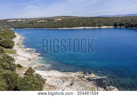 An Aerial View Of Beautiful Beach And Clear Calm Sea In Duga Uvala, Istria, Croatia