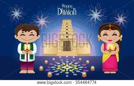 Indian Boy And Girl With Oil Lamps On Their Hands. With Colorful Fireworks, Oil Lamps And A Hindu Te