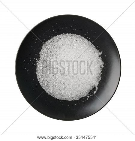 Pile Of White Citric Acid Crystals On Dark Plate Isolated