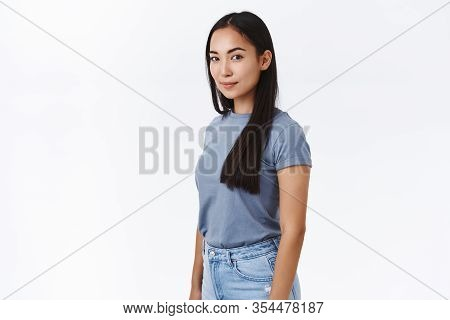 Studio Portrait Attractive Confident And Stylish Modern Asian Woman With Long Dark Hair, Standing Ha