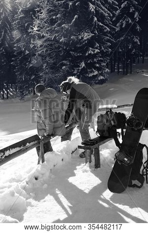 Freeriders Rest In Snowy Spruce Forest At Sunny Winter Day. Christmas Holidays In Carpathian Mountai